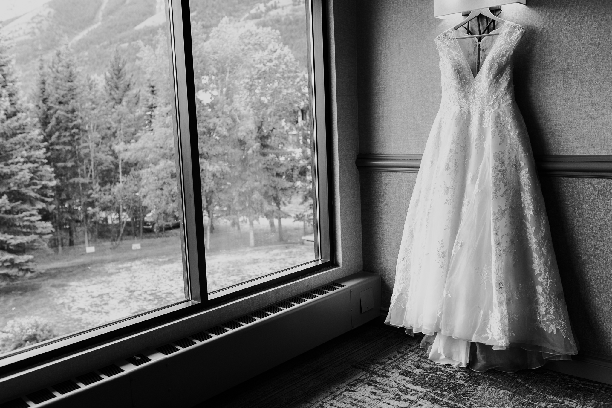 Brides gown hanging in window at Delta Kananaskis