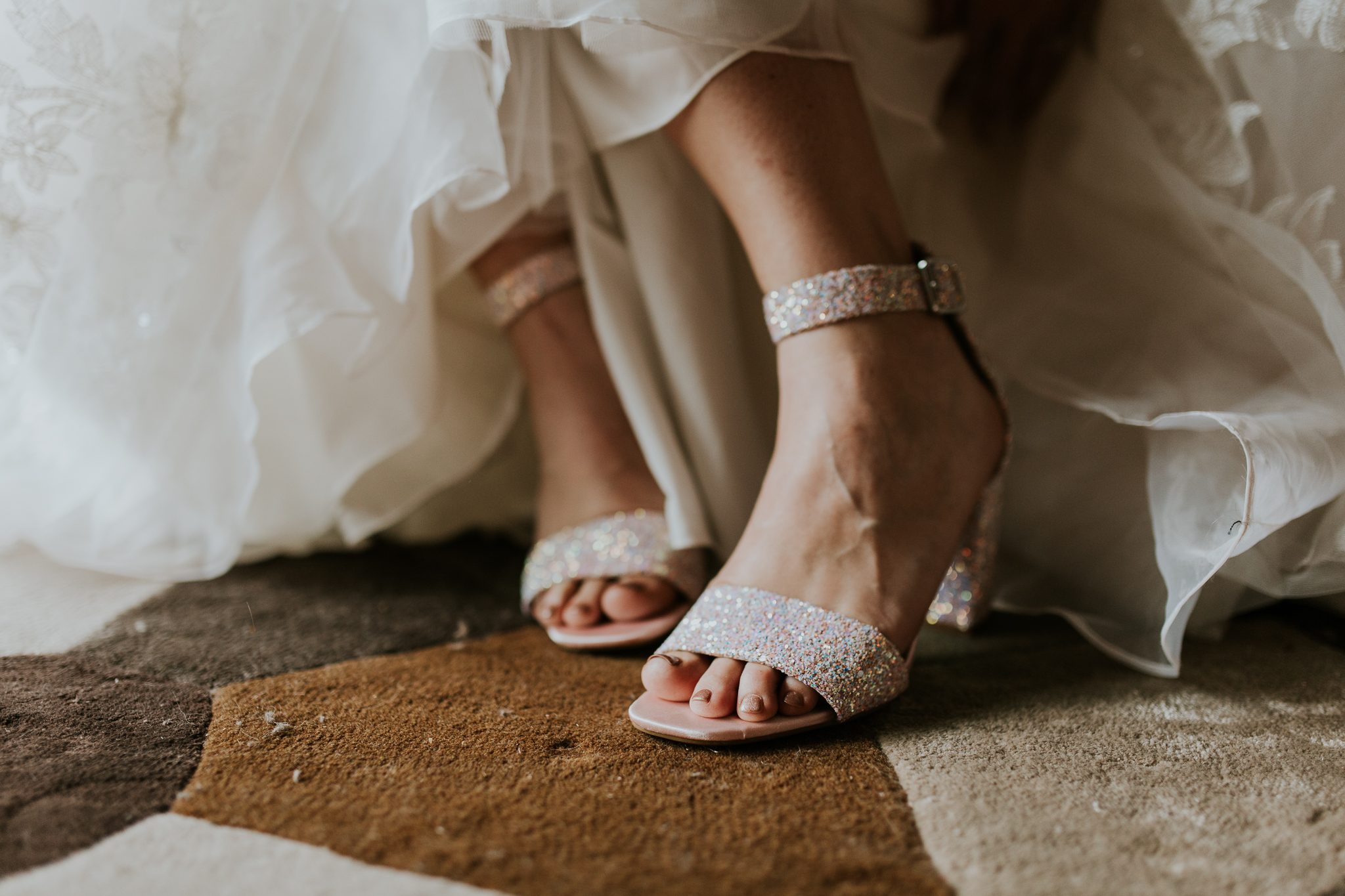 Close up of bride doing up her shoes at Delta Kananaskis