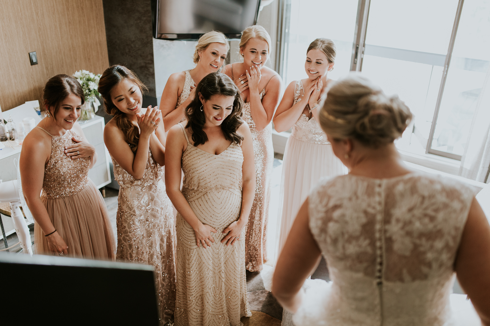 Bridesmaids reaction seeing brides gown at Delta Kananaskis