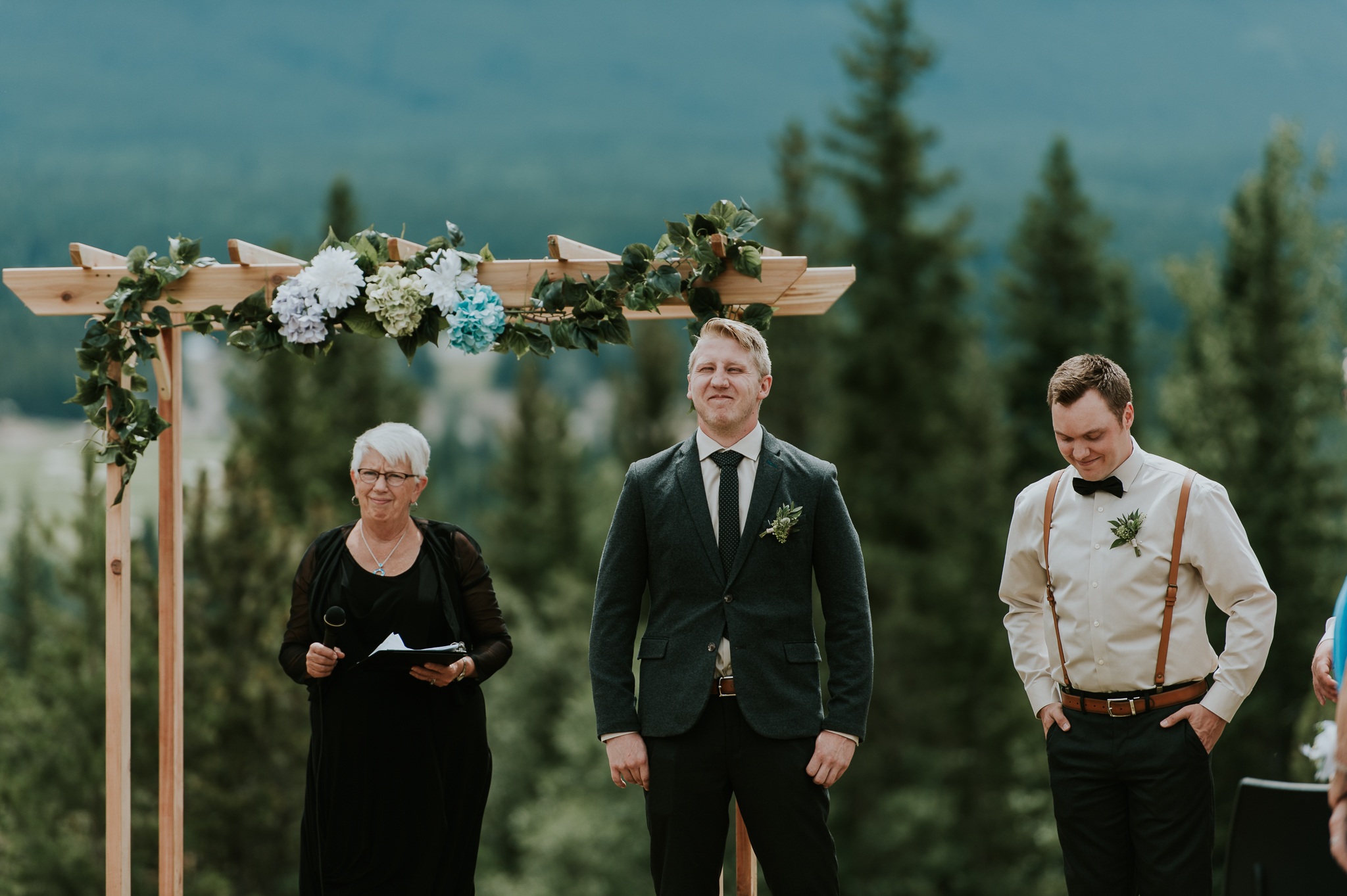 Groom's first look at bride walking down aisle at Delta Kananaskis wedding