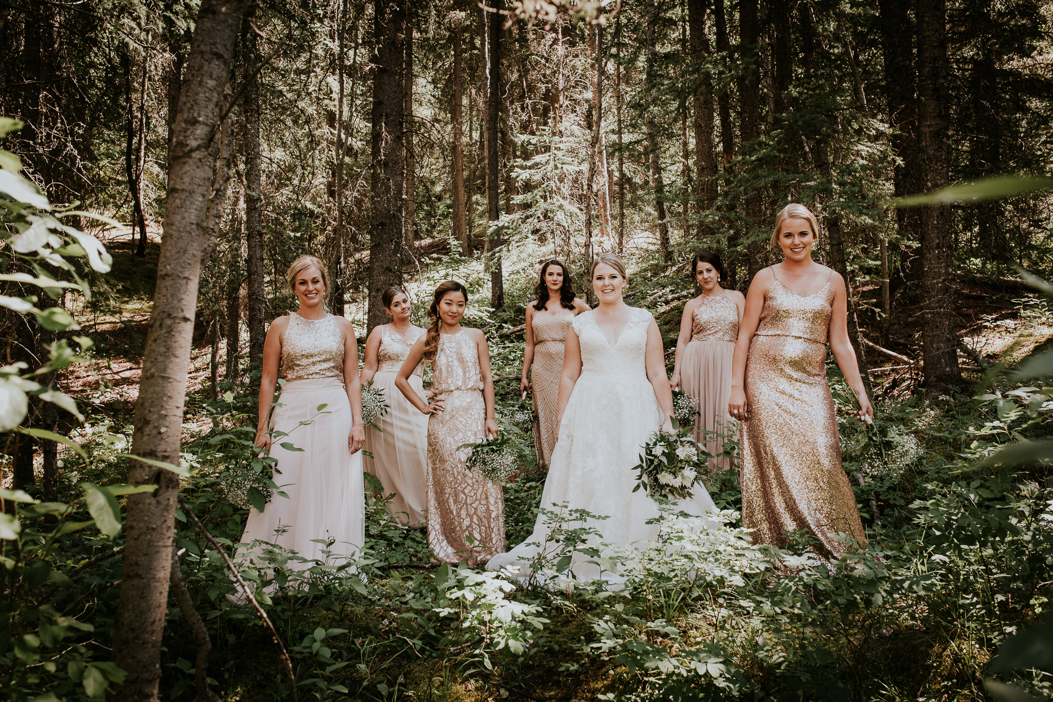 Bridesmaids in forest at Mount Lorette ponds Kananaskis