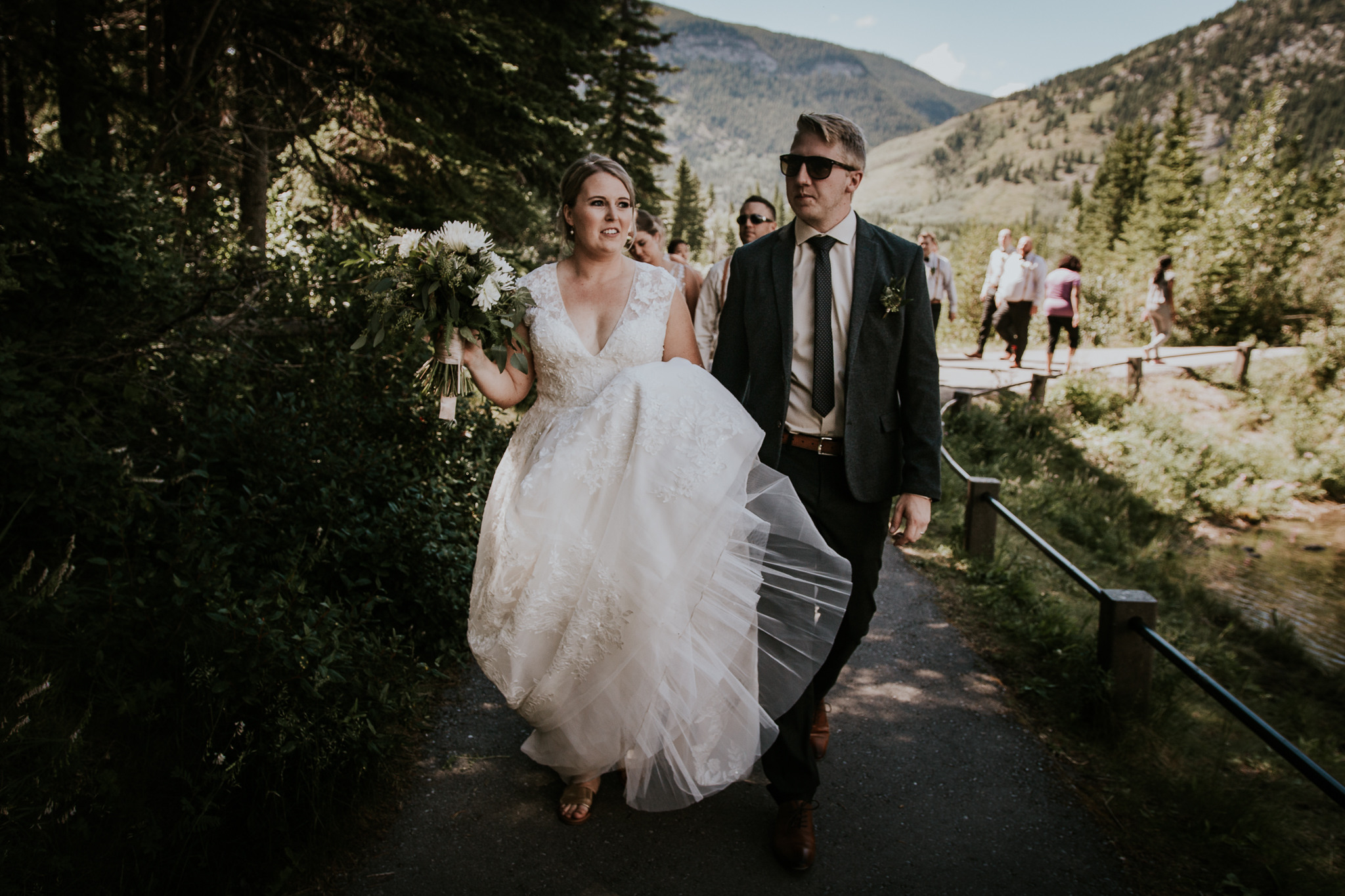 Bride and groom wearing sunglasses at Mount Lorette ponds Kananaskis