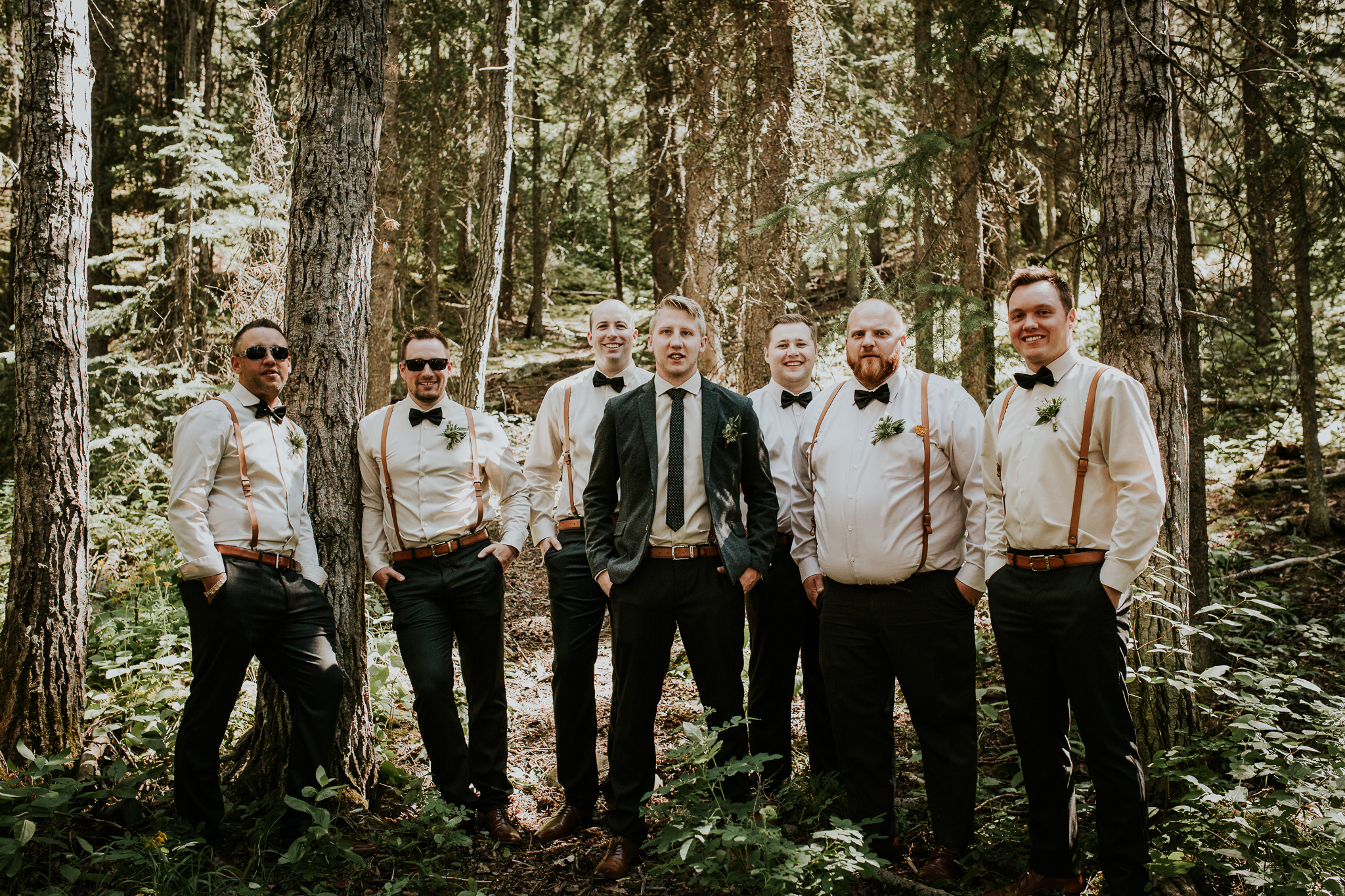 Groomsmen portraits in forest at Mount Lorette ponds Kananaskis