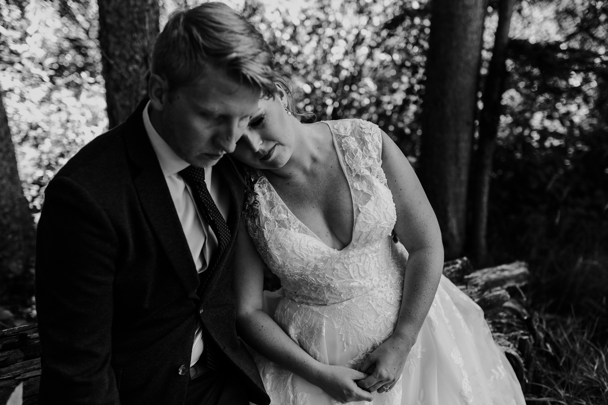 Black and white portrait of bride resting head on grooms shoulder at Delta Kananaskis