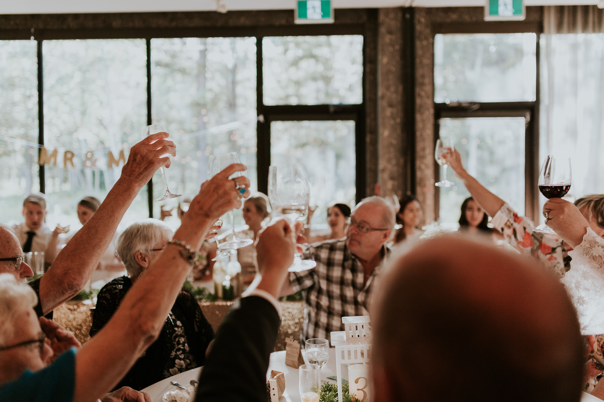 Guests cheering and toasting bride and groom at Delta Kananaskis wedding