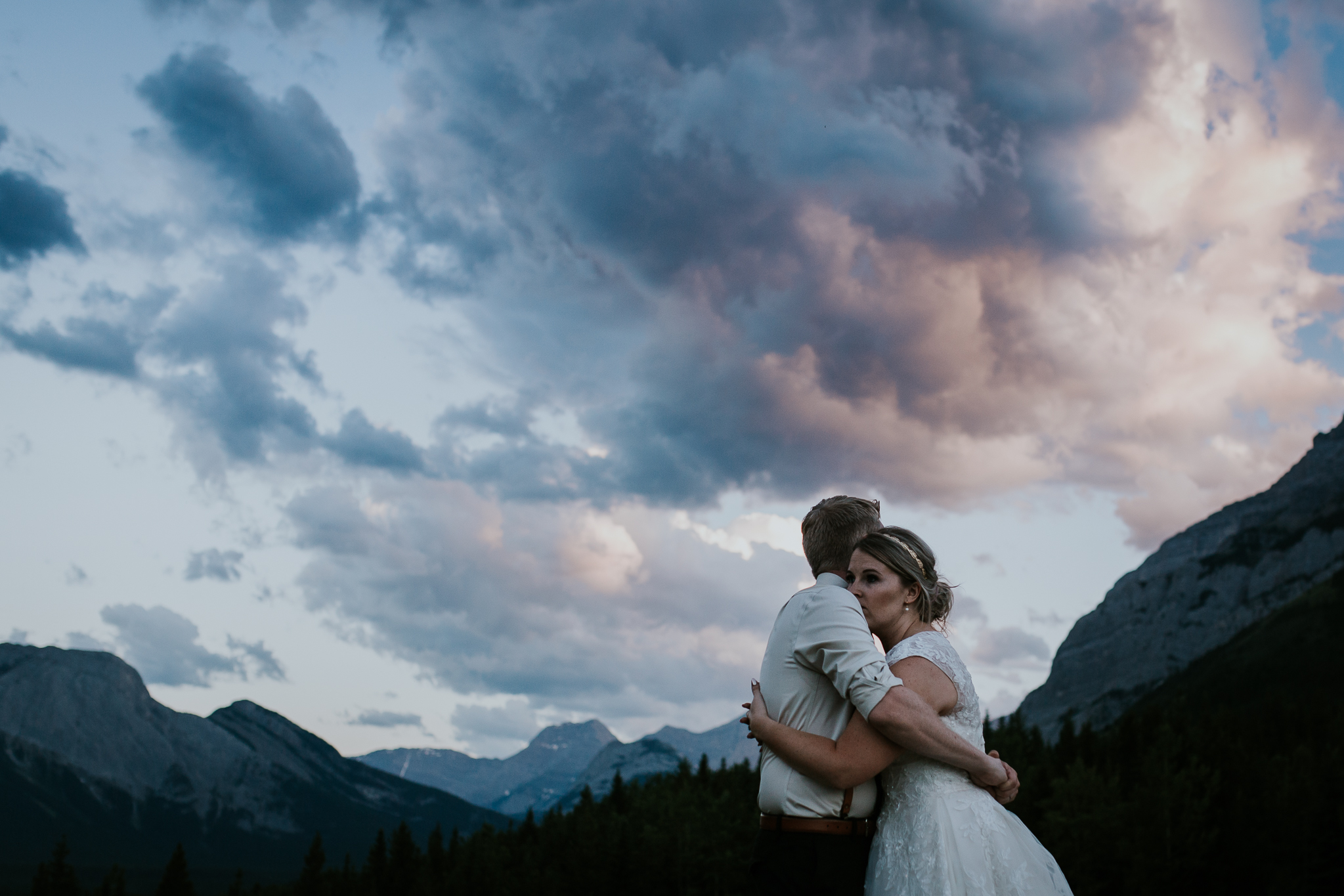 Bride and groom at sunset during photos at Delta Kananaskis wedding