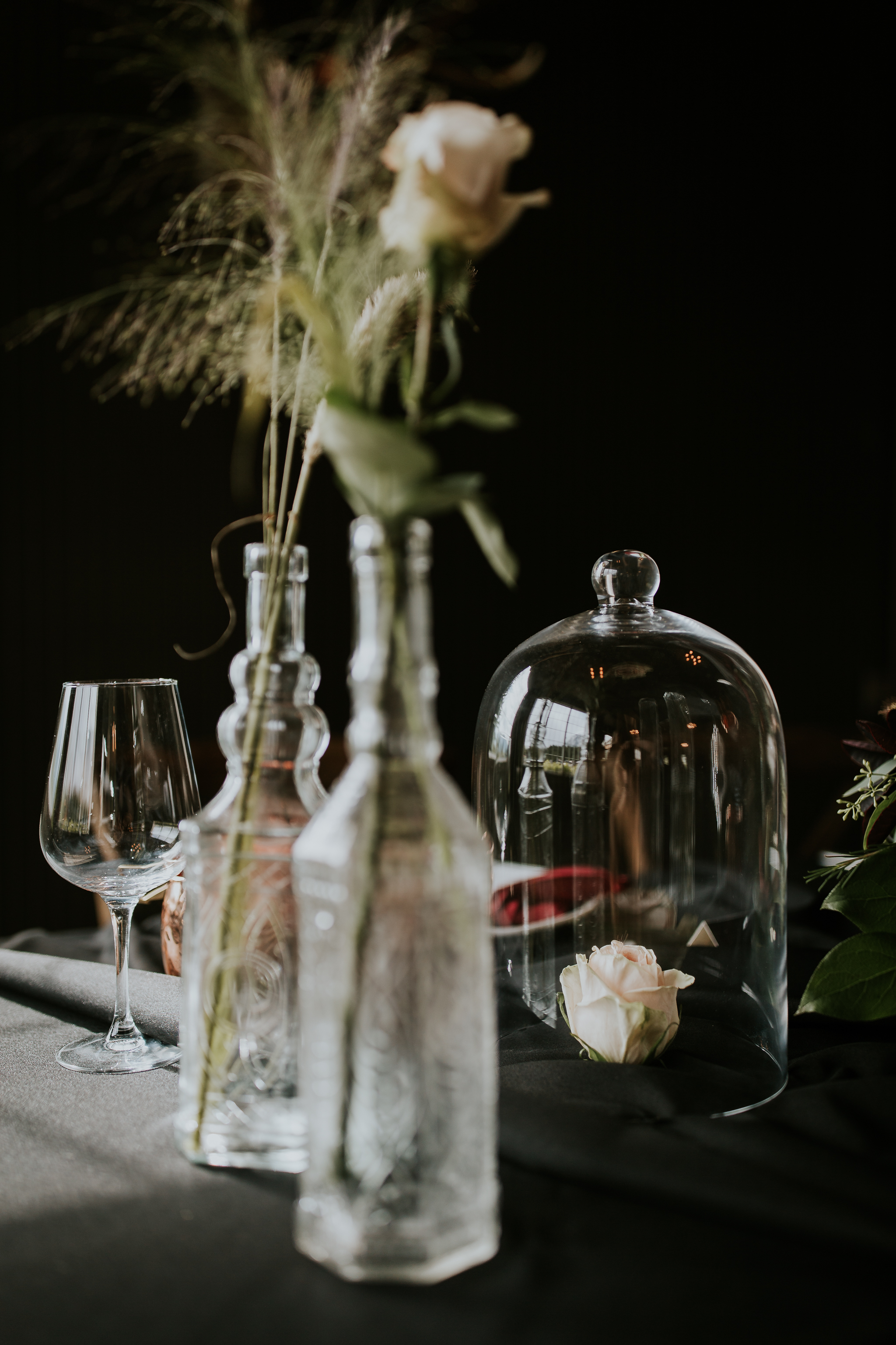 Single rose in tumbler on table like Beauty and the Beast inspired wedding photo