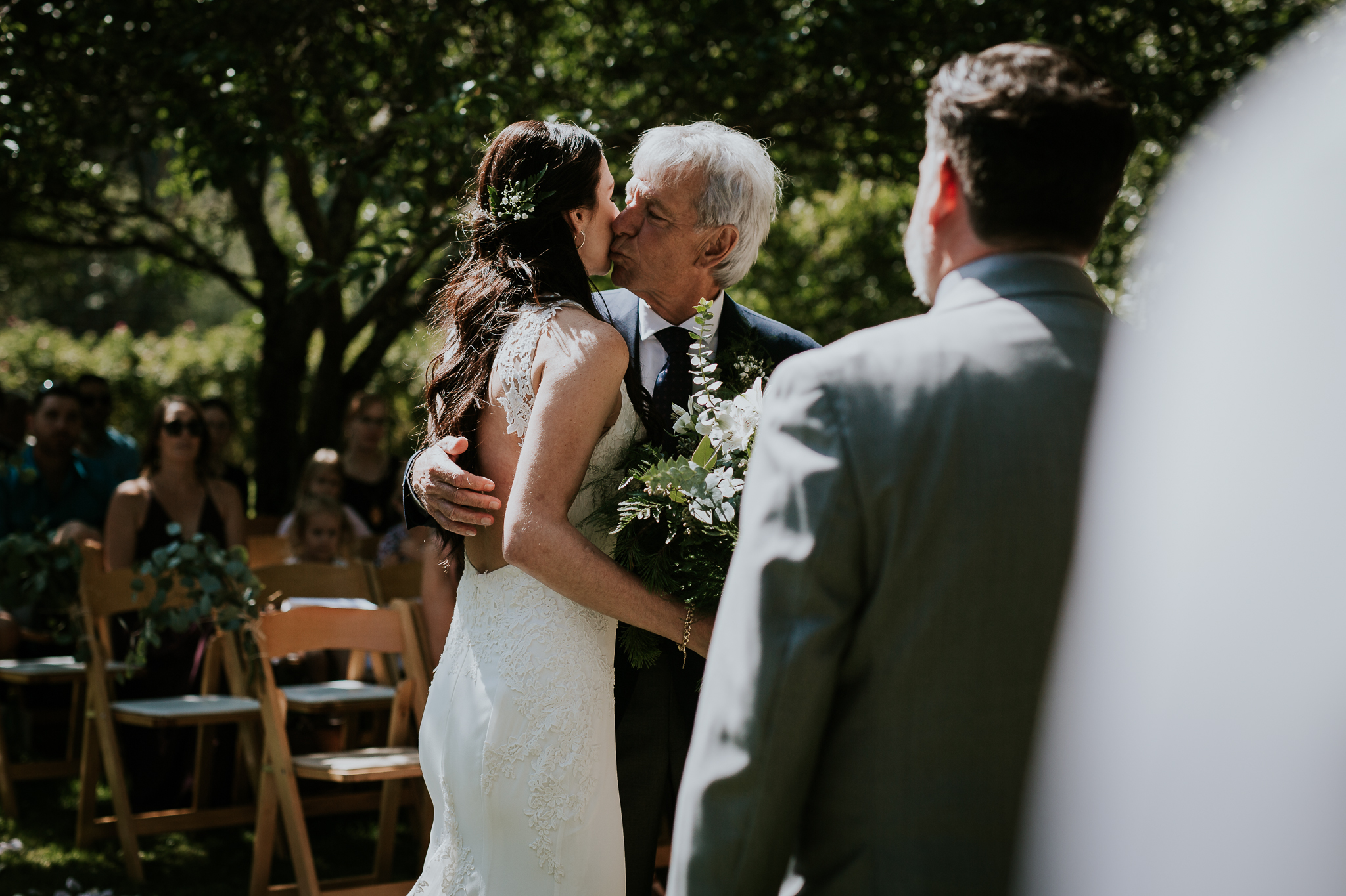 Brides father giving her away during ceremony at Starling Lane winery