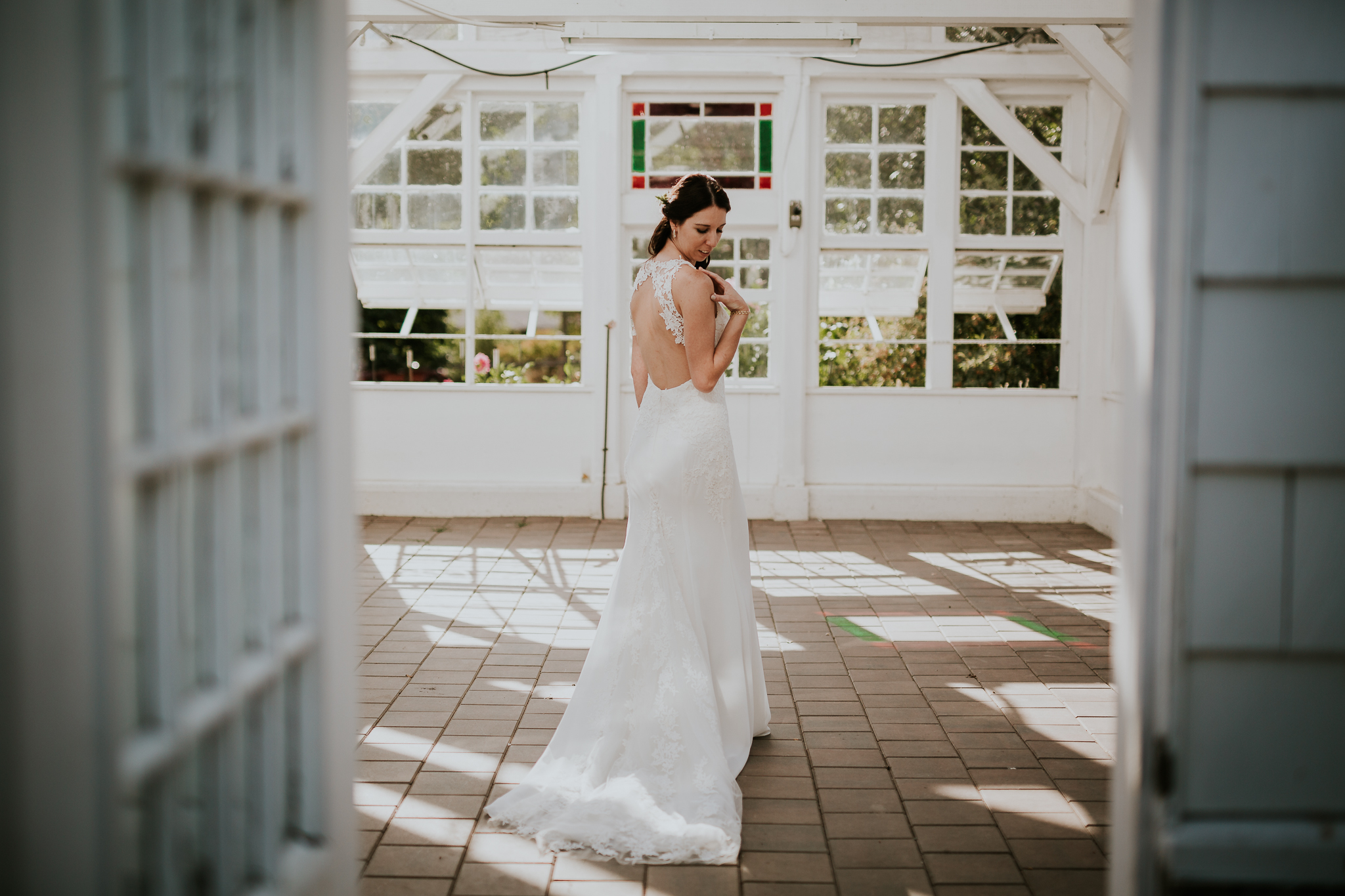 Bride inside greenhouse for wedding photos near Victoria BC Vancouver Island