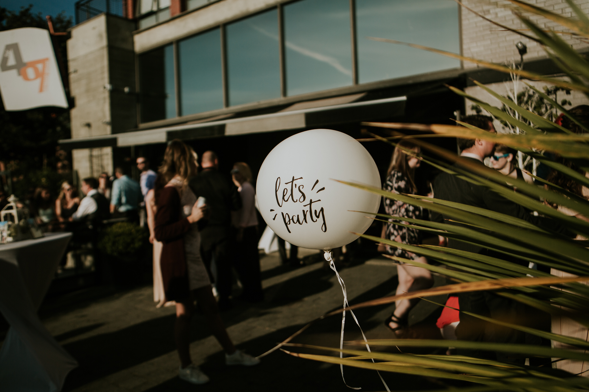 """lets party"" balloon at wedding reception in Inner Harbour Victoria BC"