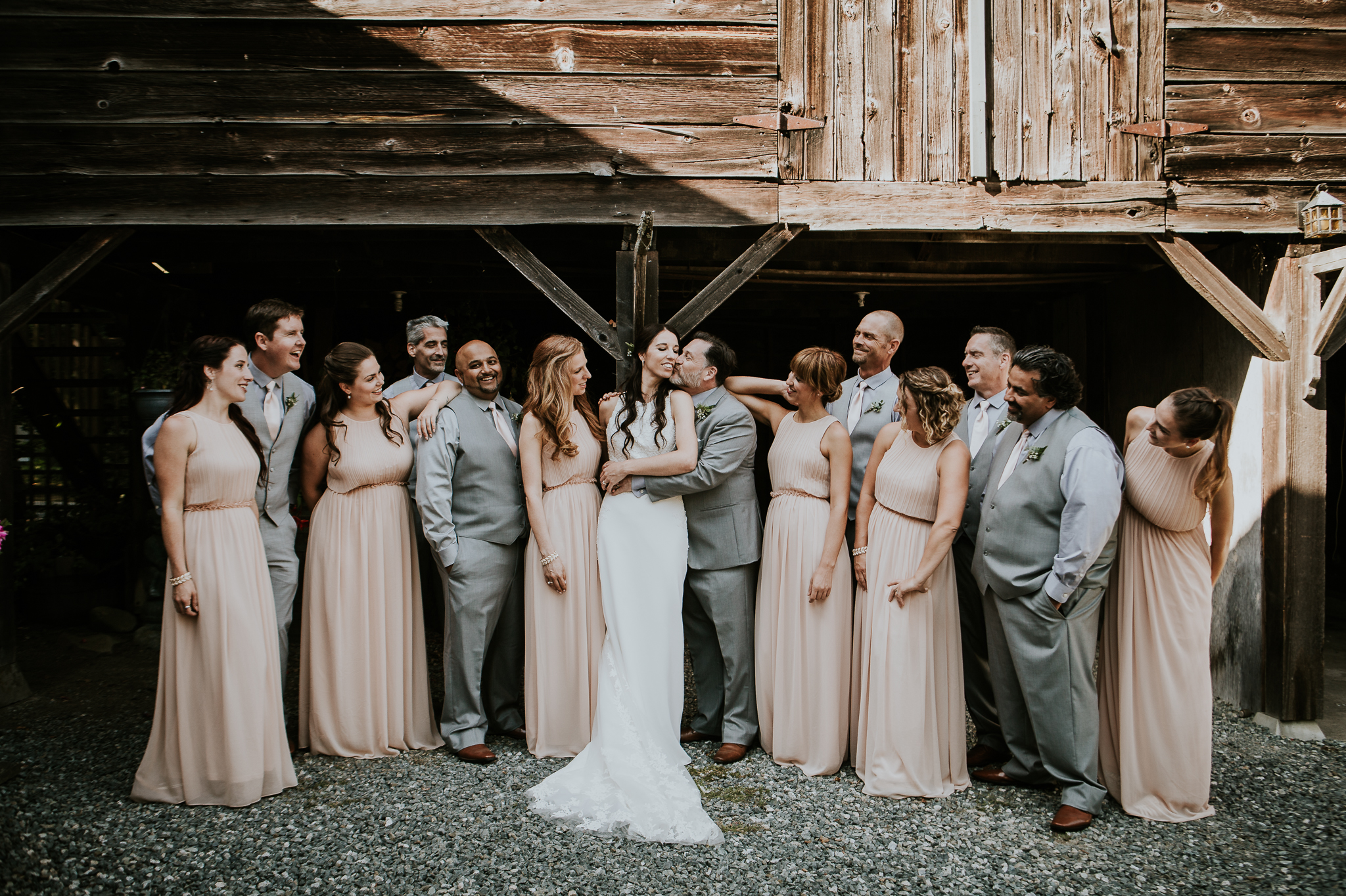 Bridal party photos in barn during vineyard wedding near Victoria BC