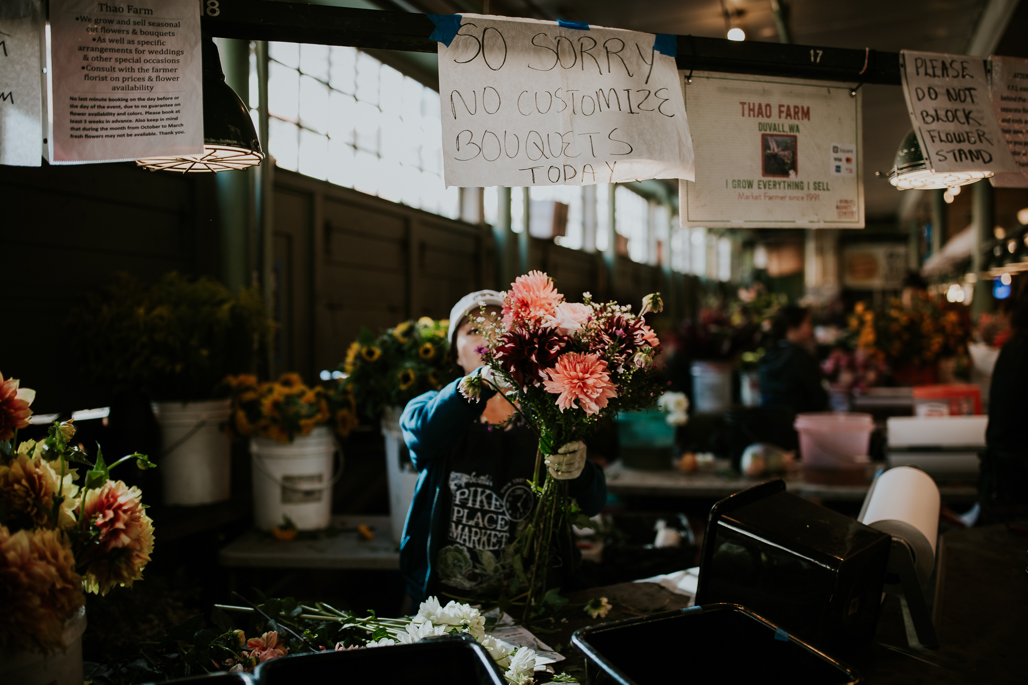 Woman selling fresh flowers at Seattle Public Market