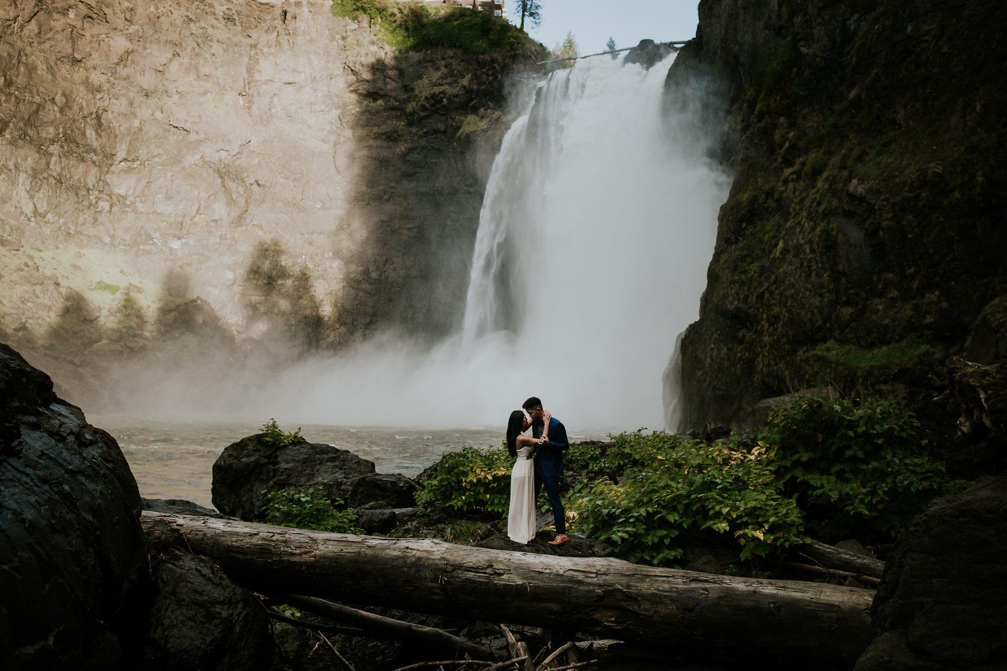 Bride and groom eloping at the base of Snoqualmie Falls