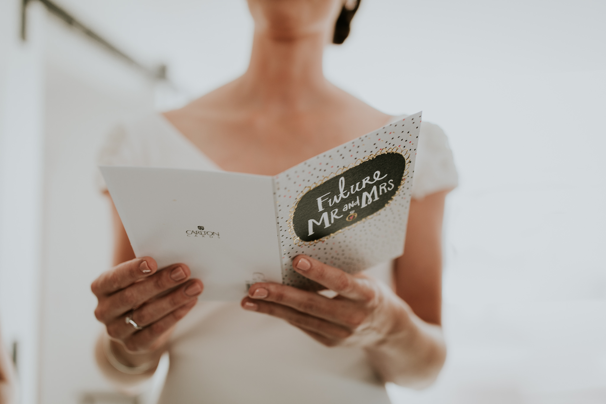 Bride reading note from the groom the day of her NZ farm wedding
