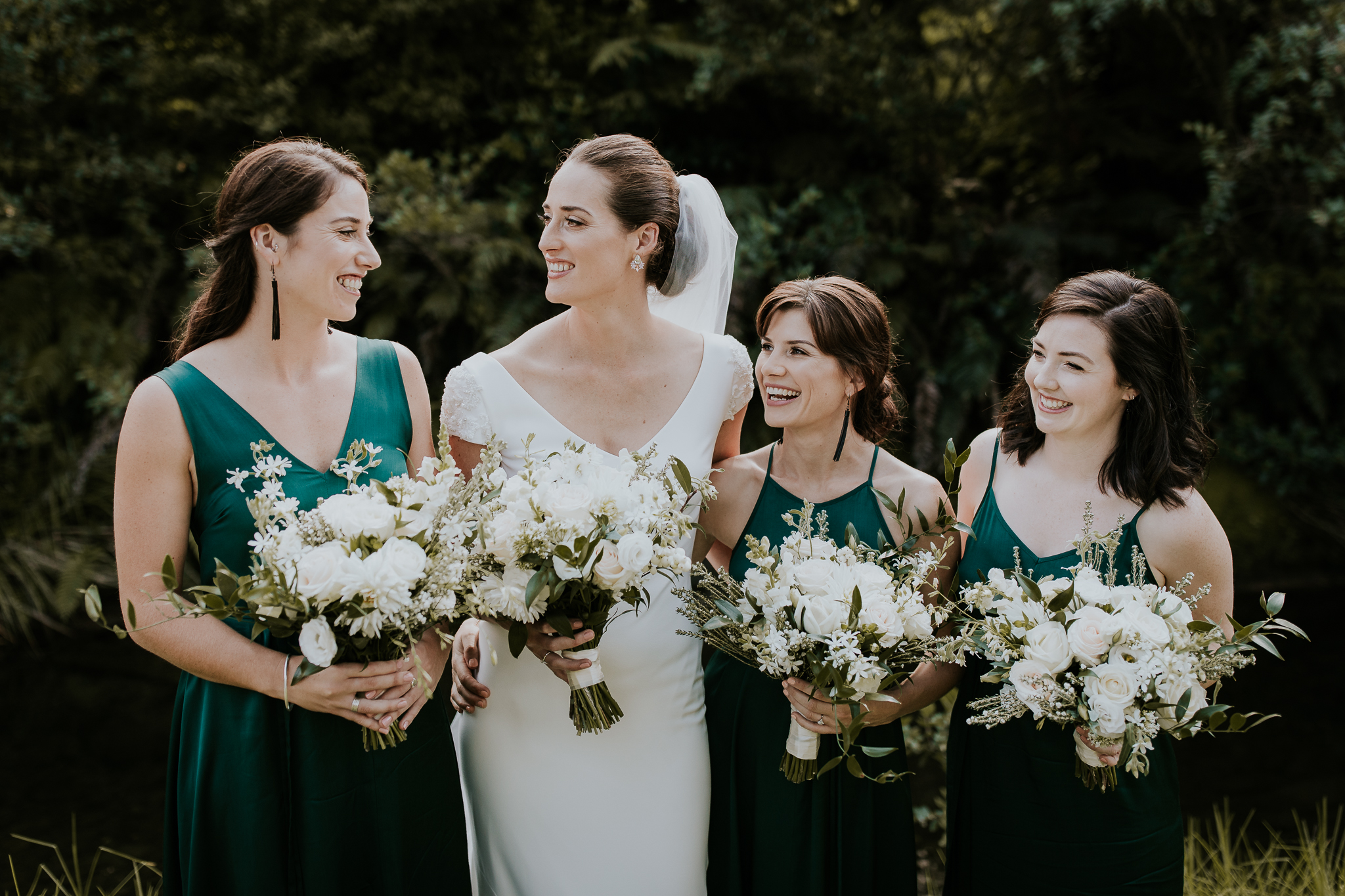 Bride and bridesmaids holding bouquets at New Zealand wedding