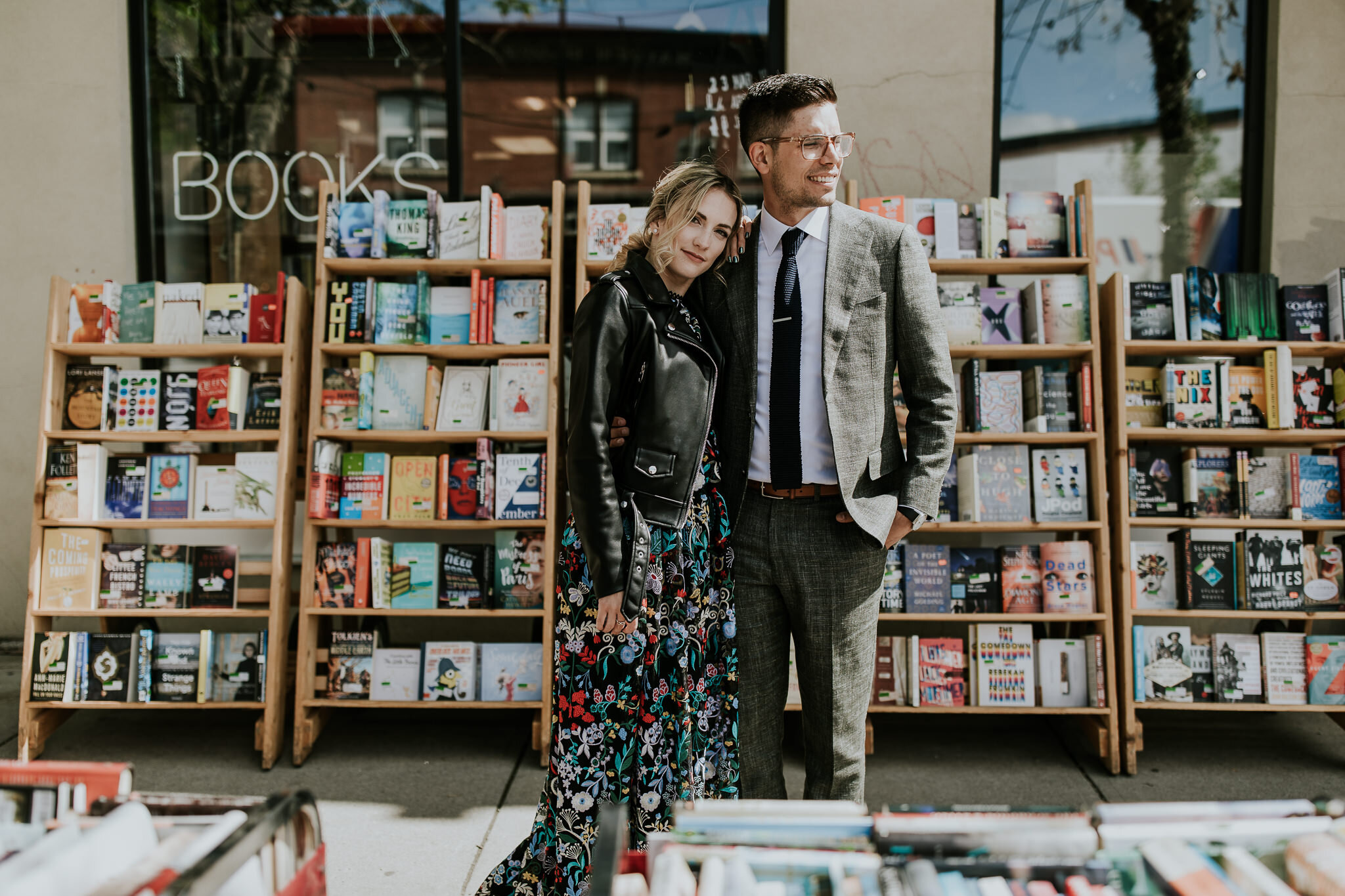 Edgy bride and groom in front of Kensington bookstore for quirky wedding photos