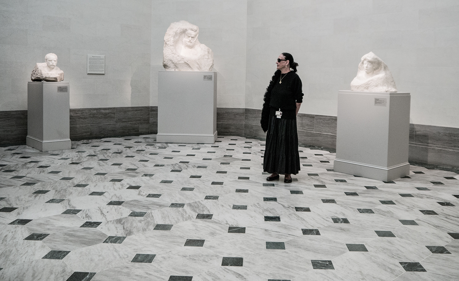 This stylish docent was an irresistible subject for an environmental portrait in the Rodin Gallery. The black tiles drawthe eye straight to her and the sculptures. She was very gracious about posing for me. It was just sheer luck that I happened upon the scene when she was the only person in the gallery.