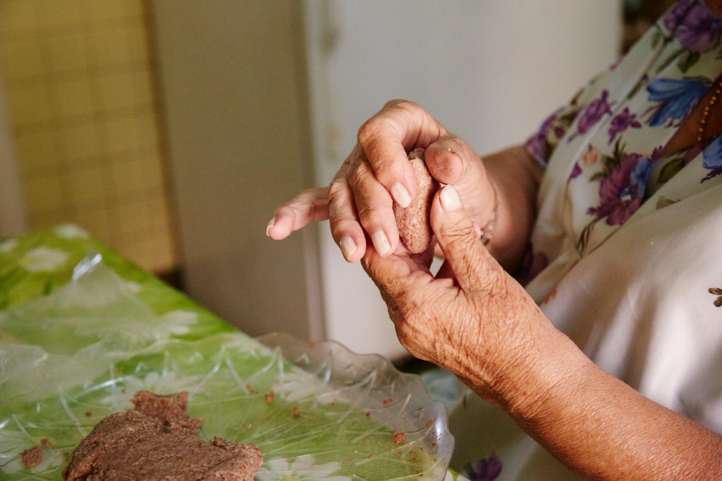 Making kibbe balls by hand   Photograph © Christina Holmes