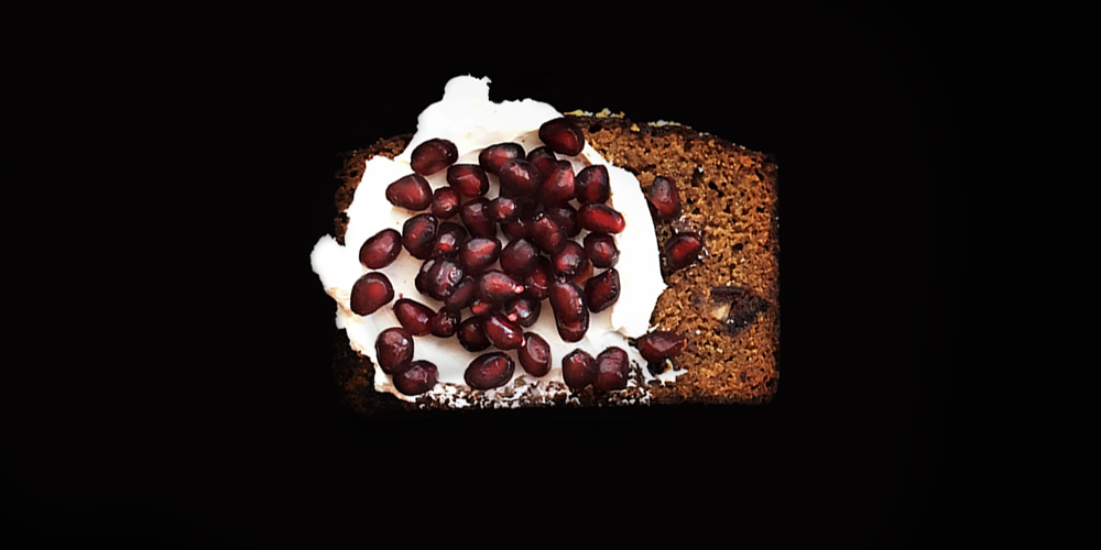 Date Nut Quickbread with labneh + pomegranate