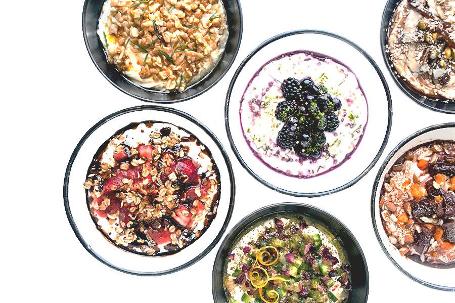 A smattering of yogurt bowls. |  Photograph by Danielle Tsi.