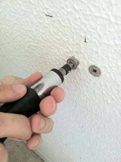 Screw them into the wall until they are flush with the surface.