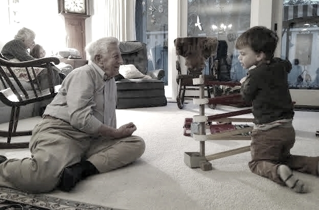 Grandpa playing marbles last year with Mason, our youngest.