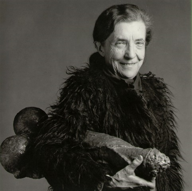 Bourgeois is seen carrying this object, nonchalantly tucked under her arm in a portrait by photographer Robert Mapplethorpe.