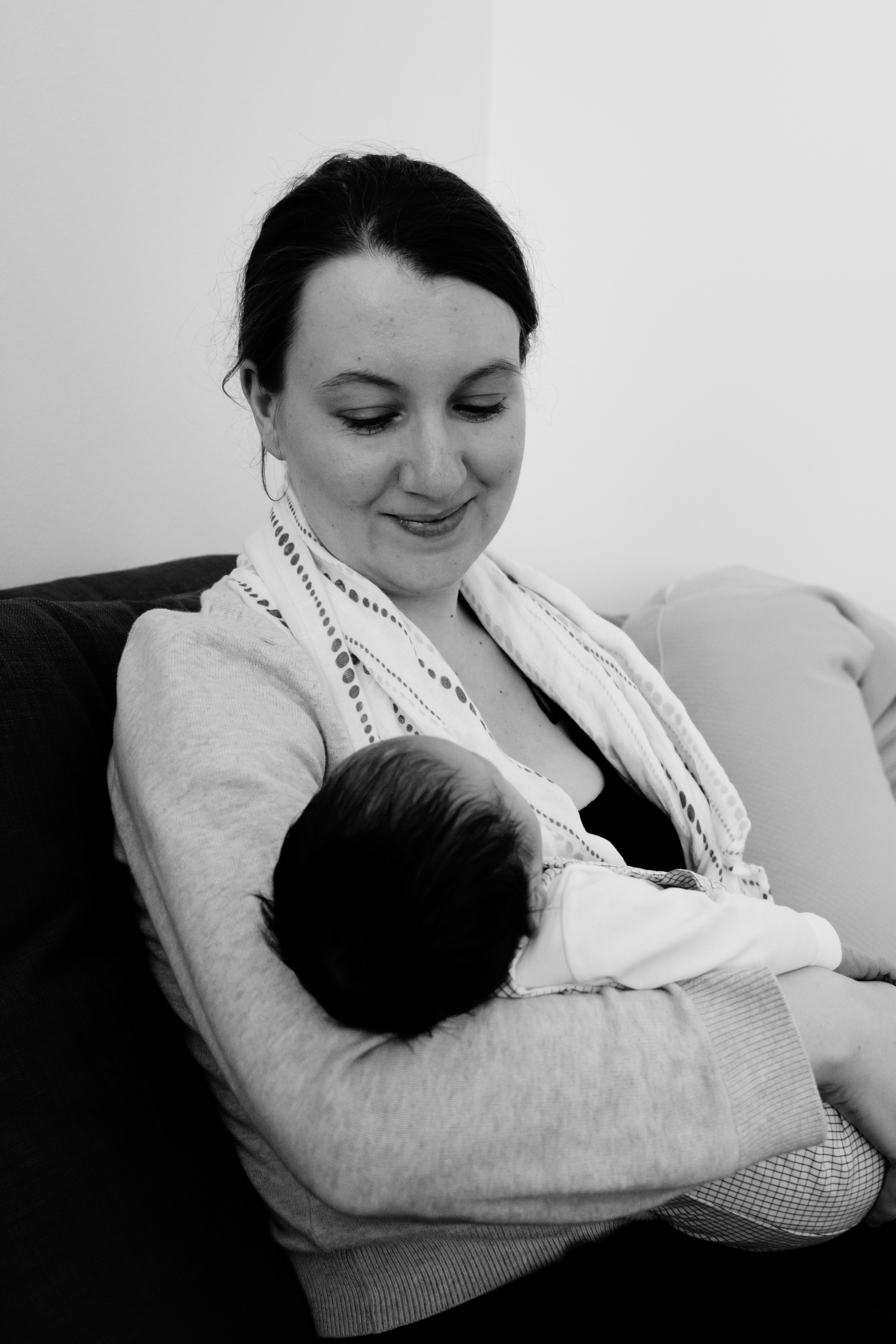New mom gazes at newborn
