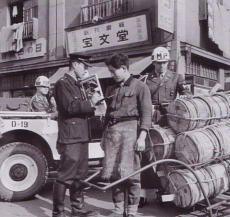 A policeman confiscates goods in 1949.