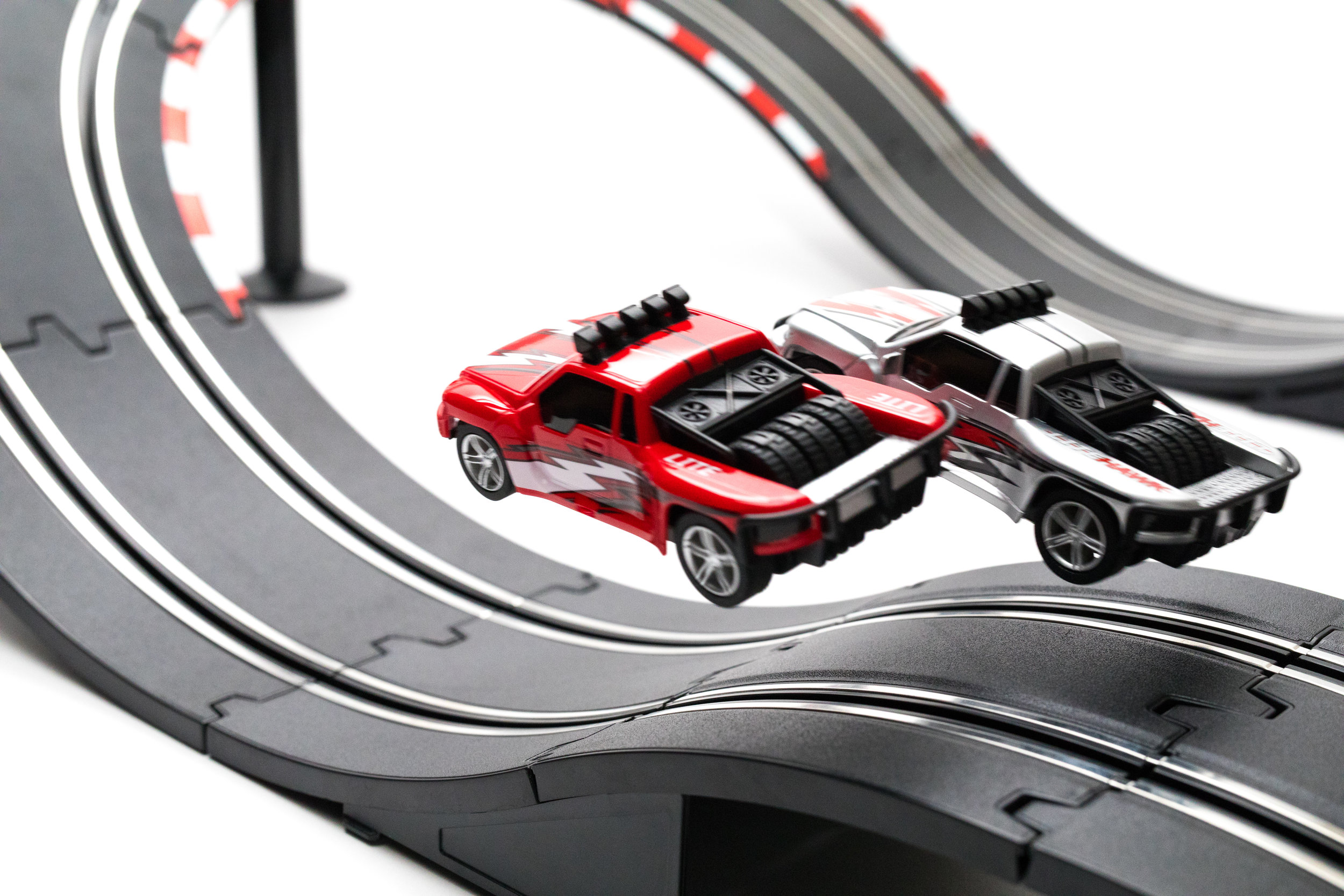 Get Some Big Air! - The Stadium Racers set is built for airborne action! Race around the track navigating jumps and sticking the landing! If you've never jumped a slot car, Stadium Racers will put a smile on your face.
