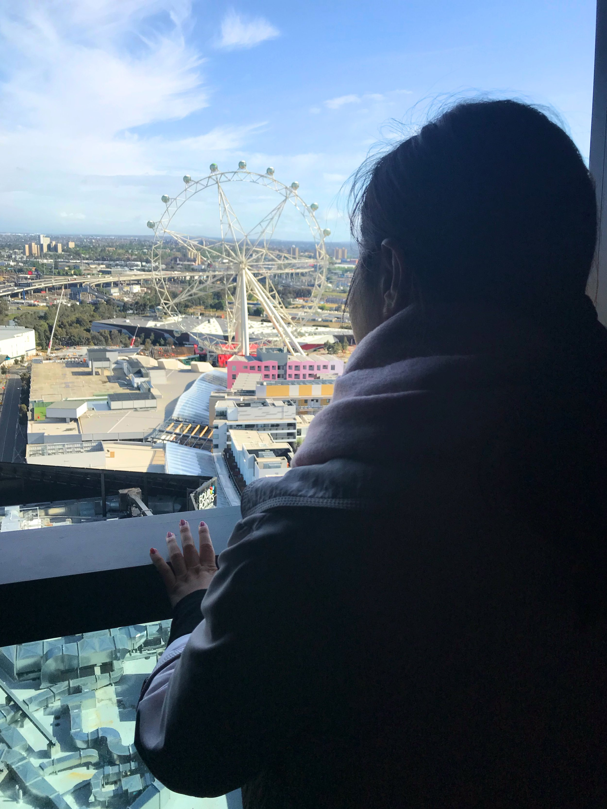 Jean Li, Sinclair Brook Accountant, checks out the view of the Melbourne Star from Level 12 of Marina Tower.