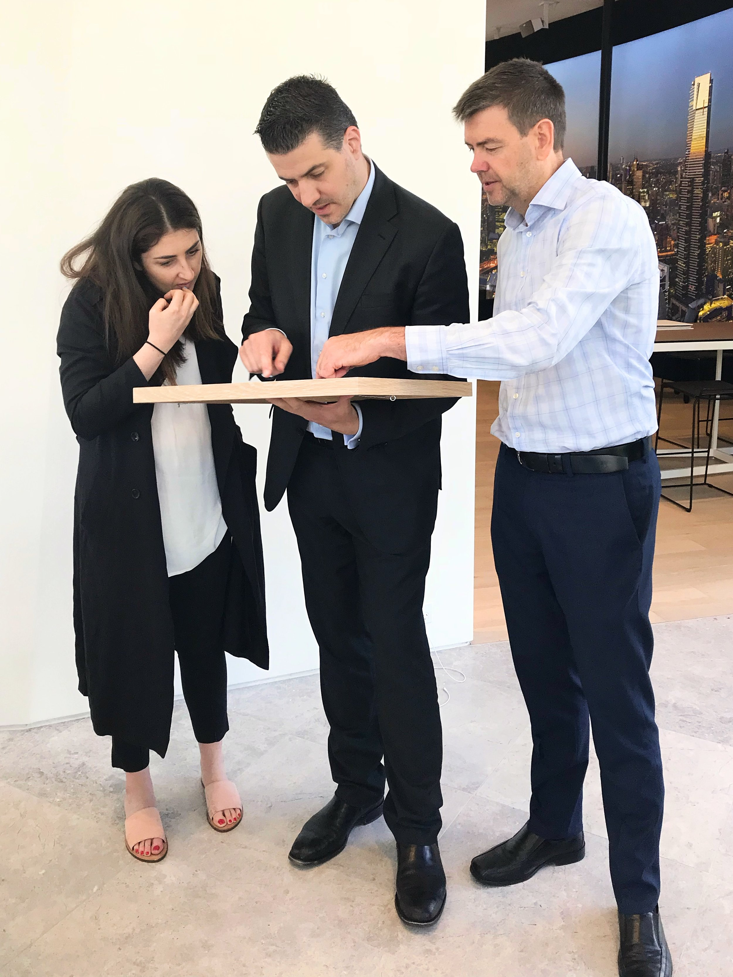 Project Manager, Jesika Smethurst, Project Manager, Andrew Mantzounis, and Construction Director, Steven Tucker, examining the Melbourne Square project.