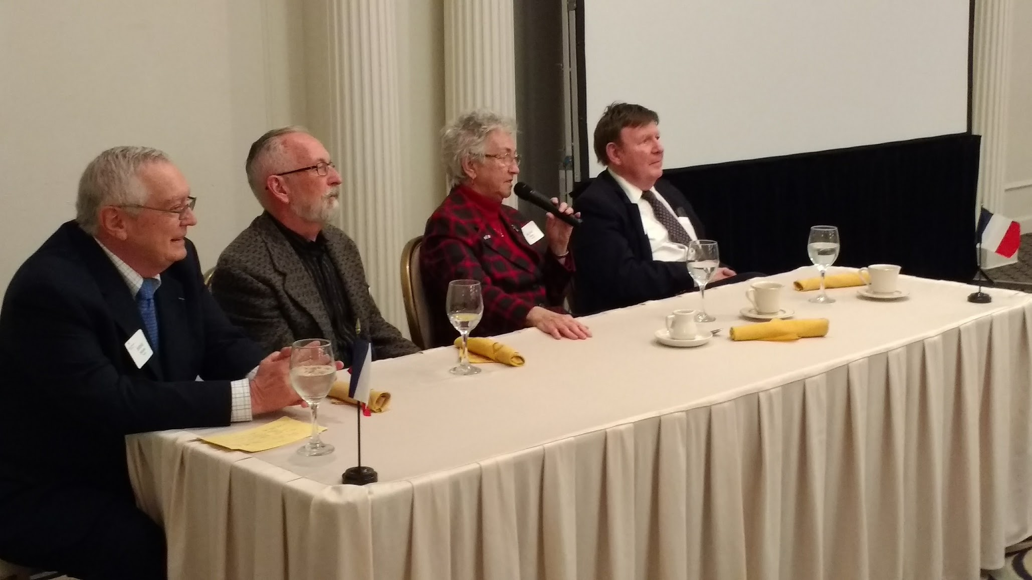 Our distinguished panelists, Bernie Duhaime, Michael James, Sr. Aline Paris, and Tom Coffey (moderator)