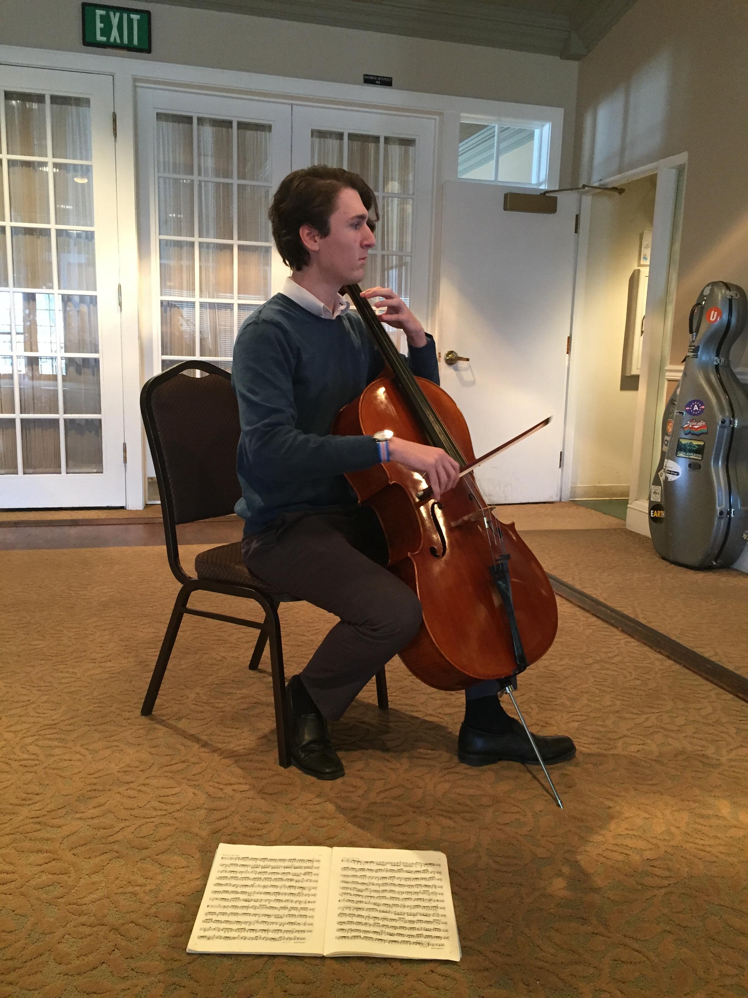 Alex Smith providing cello music during our social time.