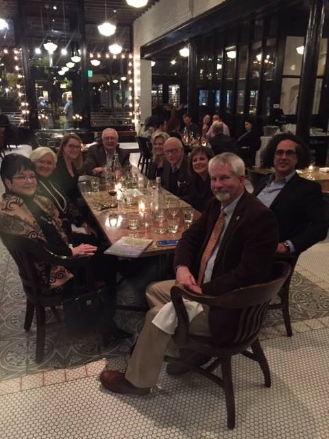 Members of the Alliance Française d'Omaha, the UNO Library, and special guests Miles Morgan and Elaine Leary celebrate before the reception at le Bouillon.