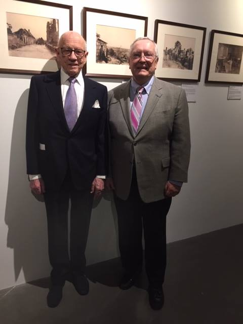 Miles Morgan, great-nephew of Anne Morgan, with former President of the Alliance Française d'Omaha Bernie Duhaime in the exhibit gallery.