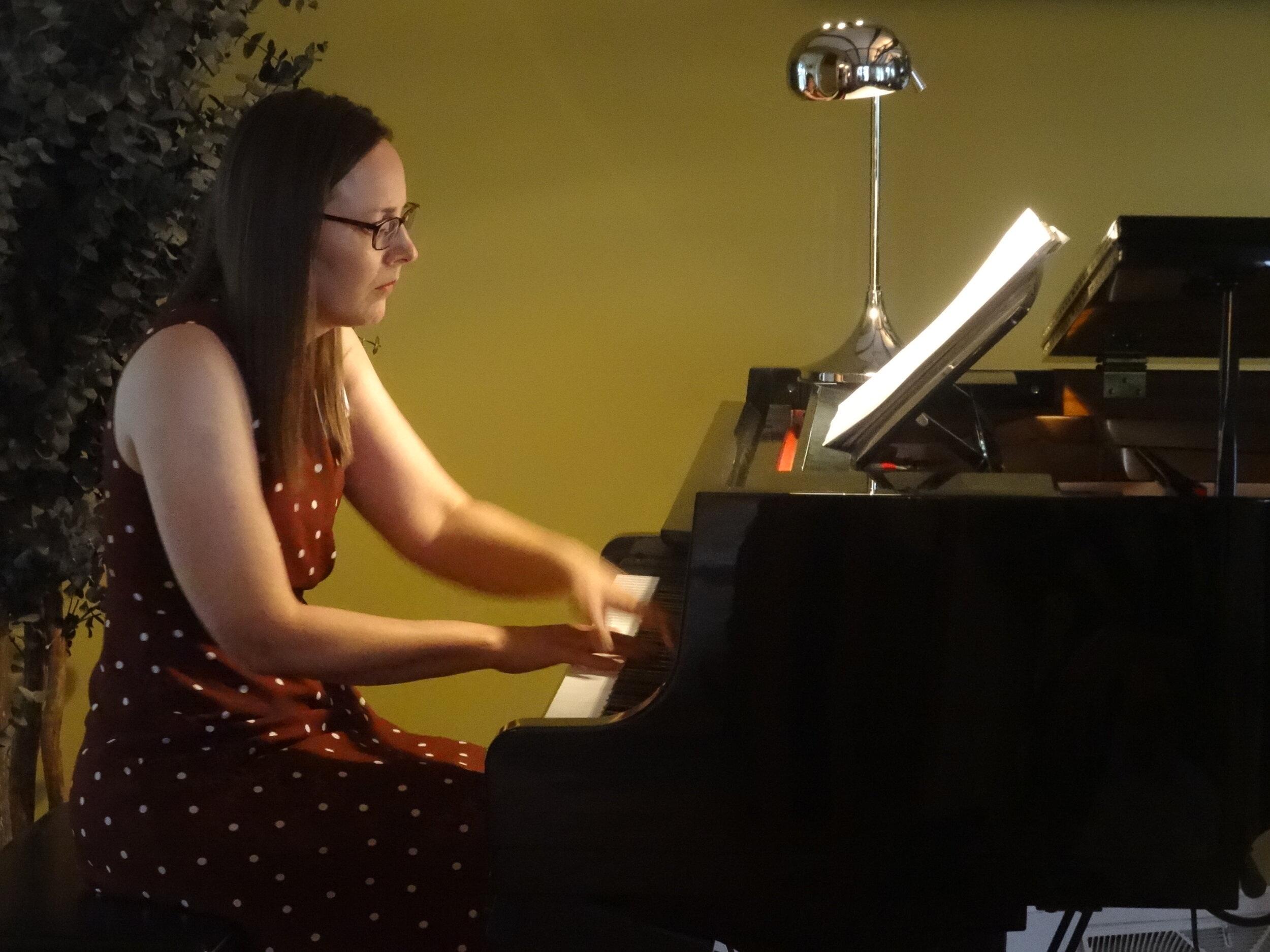 "Anne Madison performed the piano solo ""Reverie» by Debussy."