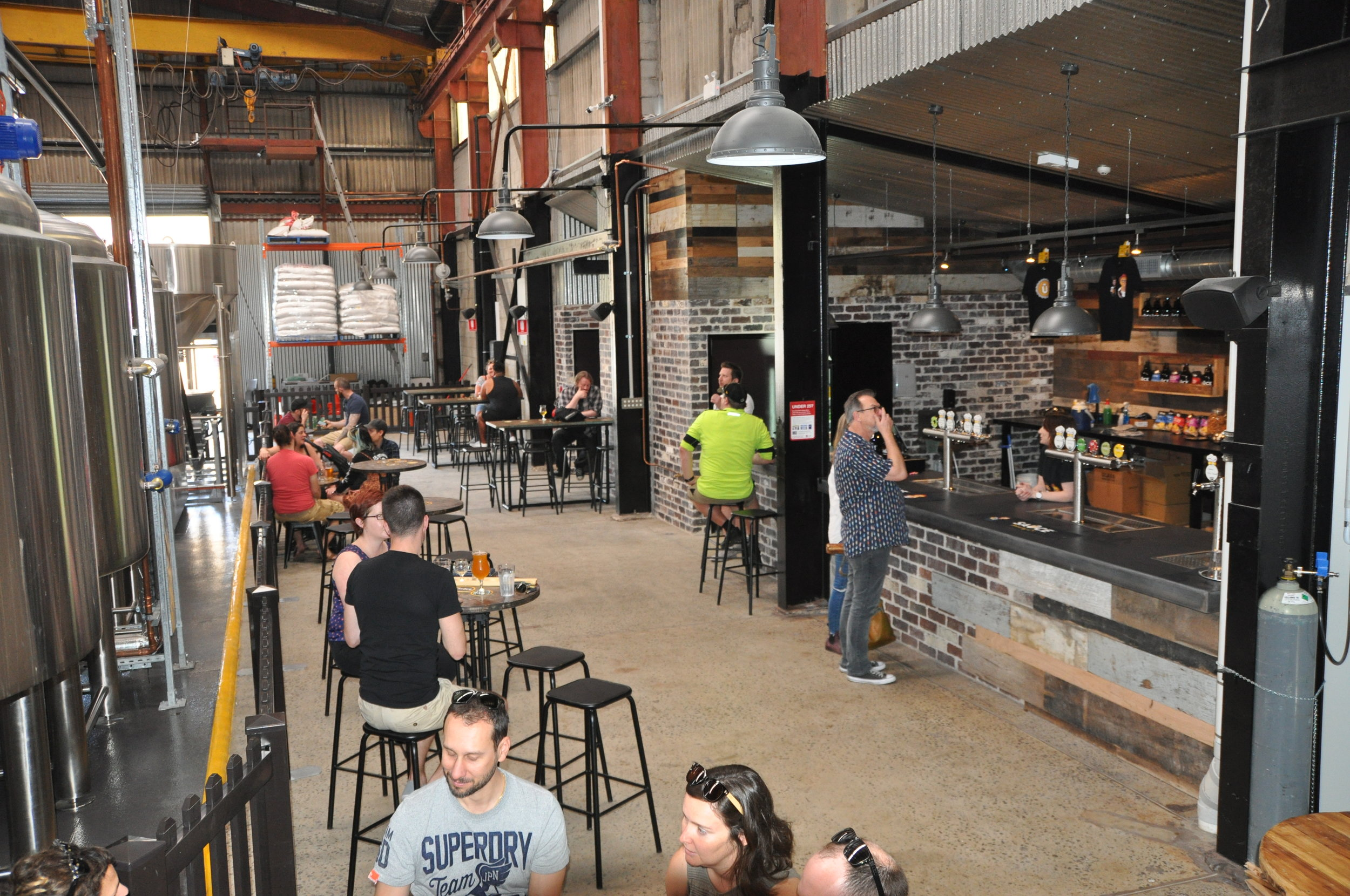 Sauce Brewing's brewhouse and fermenters (and space for a bar for customers to drink where their beer is made).