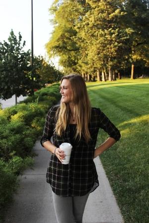 Senior Lindsey Parsons enjoying a large coffee.  PC: Jorrdan Bissell