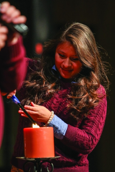 Senior Debbie Pinto lights Union's Sabbath candle.   PC: Marketing Communications
