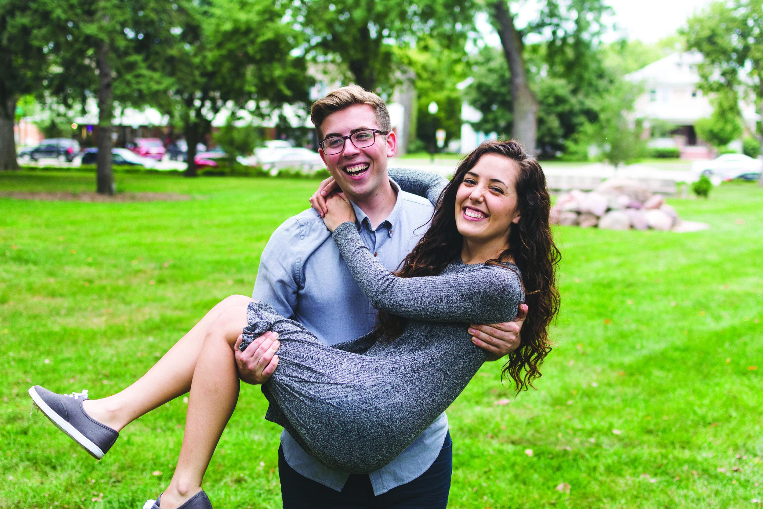 Senior business major Ryan Grentz sweeps his new fiance, Rachel Peppel, senior nursing major, quite literally off her feet. | PC: Zach Morrison