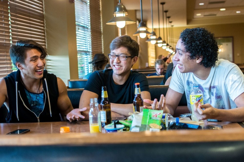 Senior Aaron Pineda, freshman David Lee and sophomore Roy Obregon chat during a meal Union Market. | PC: Zach Morrison