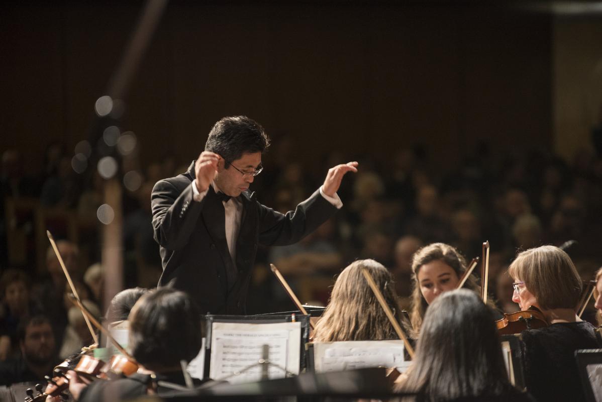 Pictured: Kurt Miyashiro directing the orchestra.   PC: Integrated Marketing Communications