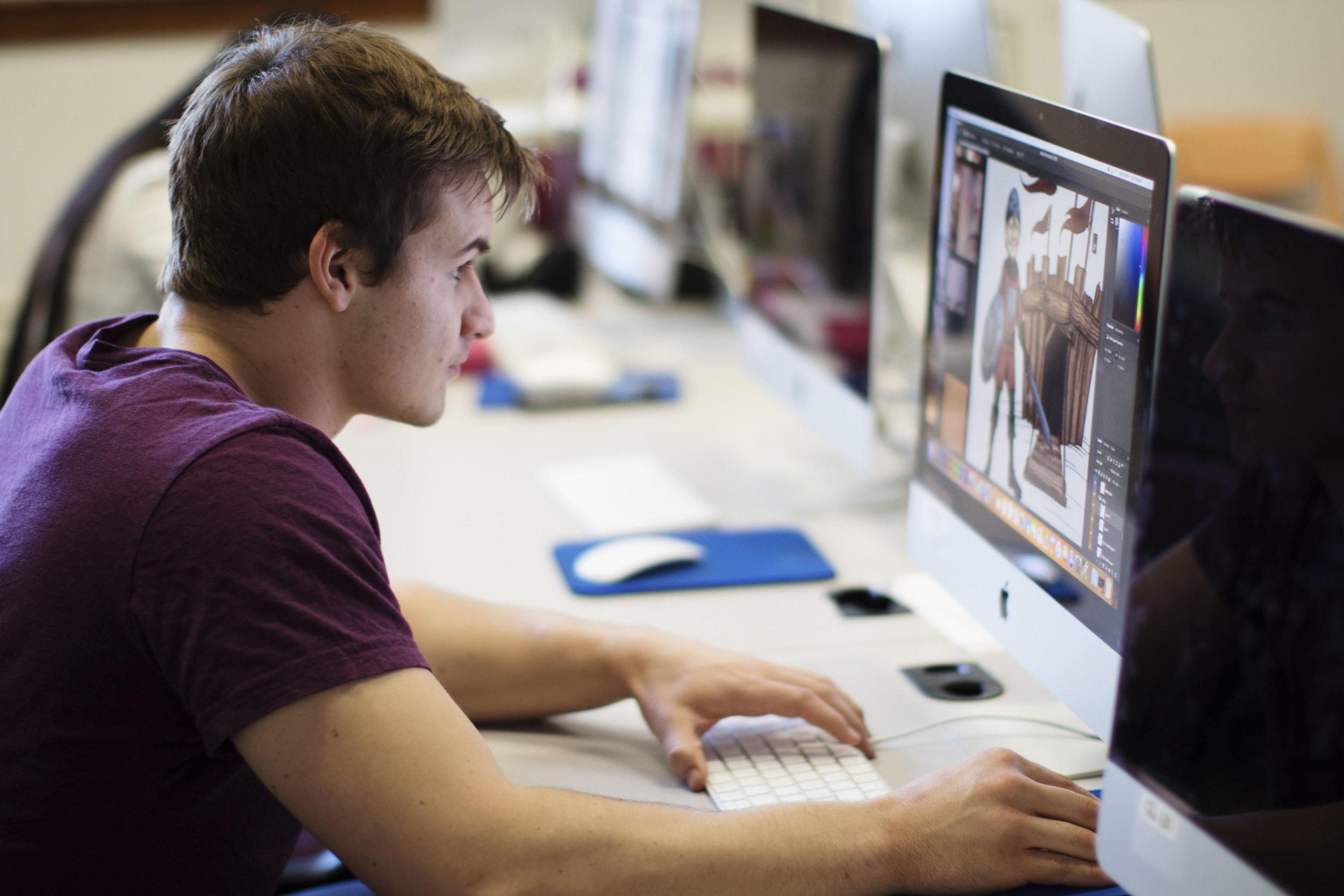 Chandler working on his Design Portfolio | PC: Kayla Potts