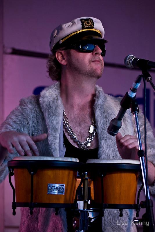 'Papa' Lovebone Wearing Captain's hat playing bongos