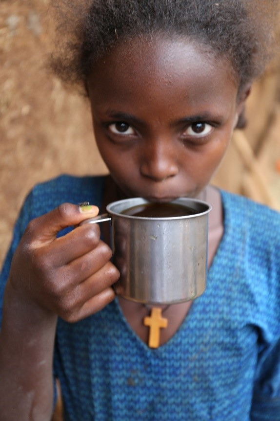 Genet Yitayih, aged 12, drinks local beer because the water is not safe
