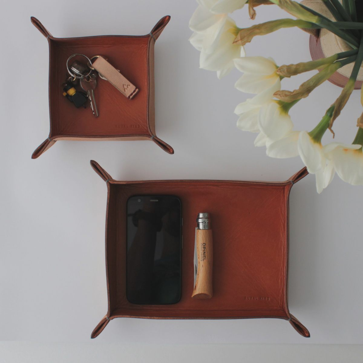 So here we are - DAY 2 #makeathingaday ..... made! Two leather organising trays moulded, folded and hand stitched from a flat piece of oak bark tanned leather. Perfect for keys, coins, phone (or another home for your opinel)