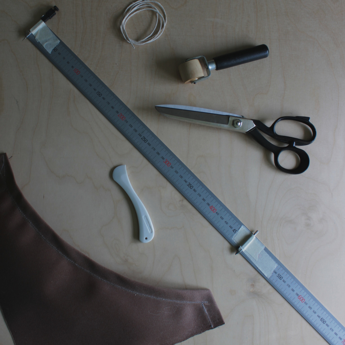 Test piece sewn, and some of the tools used so far (including diy ruler compass!). A few expletives muttered whilst trying to get this curved bit right (!) onto marking out the fabric for real