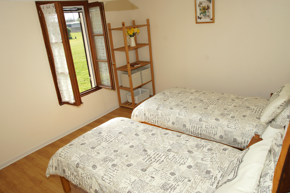 Twin bedroom with views across garden