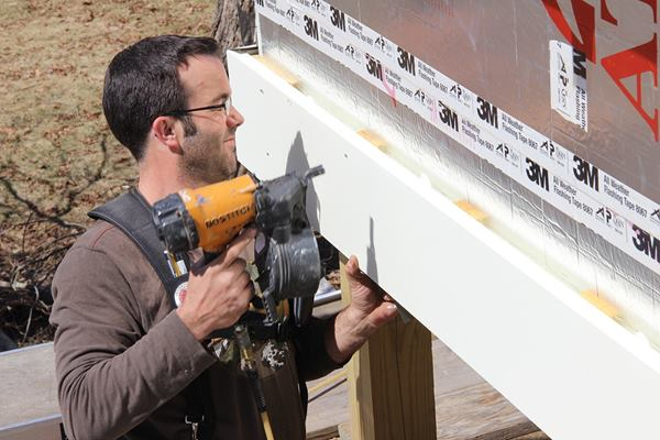 A closer look: Pollard fastens the pre-primed wood trim to the 1x4 rain screen furring using stainless steel ring shank nails.